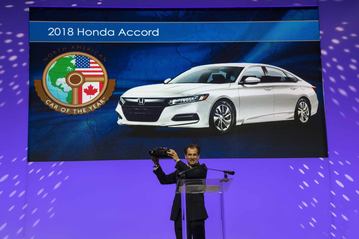 Henio Arcangeli, Senior Vice President of the Automobile Division of American Honda Motor Co., accepts the award for 2018 North American Car of the Year at the 2018 North American International Auto Show on 1/15/18.